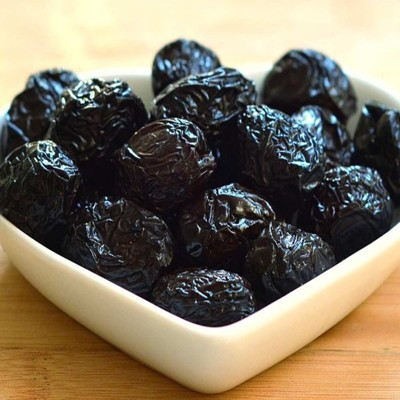Black olives with stone in brine